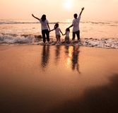 Happy Family Holding Hands Stock Photo
