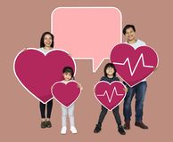 Happy family holding a pink heart icons stock illustration