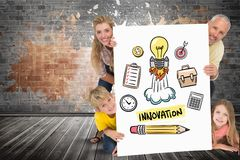 Happy family holding placard with innovation text and icons Royalty Free Stock Images