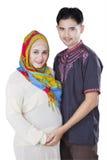Happy family holding pregnant tummy Royalty Free Stock Photography