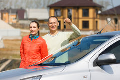 Happy family holds   keys to  car Stock Photos