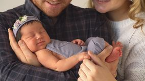 Happy Family Holds Newborn Daughter. 4k stock video footage