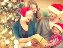Happy family at home celebrating Christmas Stock Image