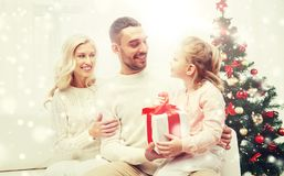 Happy family at home with christmas gift Royalty Free Stock Images