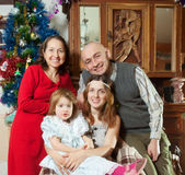 Happy family at home in Christmas Stock Images
