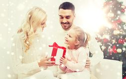 Happy family at home with christmas tree Royalty Free Stock Images