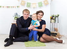 Happy family at home. Father, mother and one year old toddler boy at home Royalty Free Stock Photos
