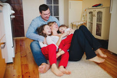 Happy family at home on the floor Royalty Free Stock Photos