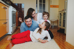 Happy family at home on the floor Royalty Free Stock Images