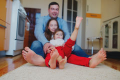Happy family at home on the floor Stock Photography