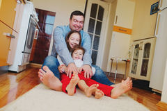 Happy family at home on the floor Stock Images