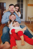 Happy family at home on the floor Royalty Free Stock Photo