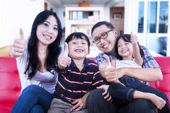 Happy family at home giving thumbs up Royalty Free Stock Image