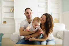 Happy family at home. Mom, dad and son royalty free stock images