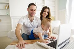 Happy family at home. Mom, dad and son royalty free stock image
