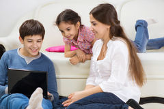 Happy family at home. Happy mother with her little children at home Stock Photo