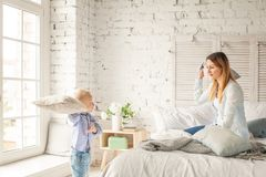 Happy Family at Home. Mother and Son Having Fun. Pillow Fight Royalty Free Stock Images