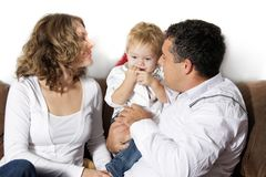 Happy family at home over white Royalty Free Stock Photo