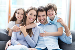 Happy family at home. Smiling family relaxing at home stock images