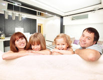 Happy family at home on sofa. Family with two children on sofa Stock Image