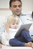 Happy family at home with tablet Stock Photography