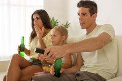 Happy family at home watching TV Stock Photography