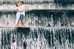 Happy family honeymoon holiday. Couple in cascade waterfall pool. stock photography
