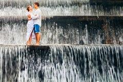 Happy family honeymoon holiday. Couple in cascade waterfall pool. royalty free stock photo