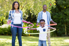 Happy family hooping together Stock Photo