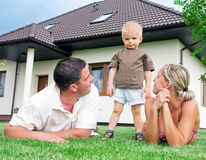 Happy family and house stock photography