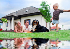 Happy family and house. Happy family in front of their house Royalty Free Stock Images