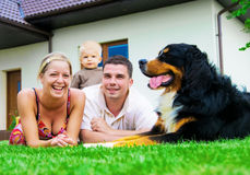 Happy family and house. Happy family in front of their house Stock Image