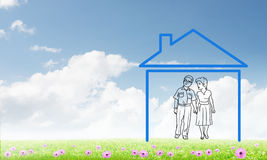 Happy family in house. House figure as real estate symbol on clouds background Royalty Free Stock Photos