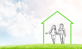 Happy family in house. House figure as real estate symbol on clouds background Stock Images