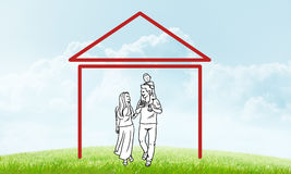 Happy family in house. House figure as real estate symbol on clouds background Royalty Free Stock Photo