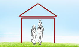 Happy family in house. House figure as real estate symbol on clouds background Royalty Free Stock Image