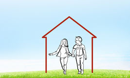 Happy family in house. House figure as real estate symbol on clouds background Stock Image