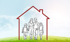 Happy family in house. House figure as real estate symbol on clouds background Royalty Free Stock Photography