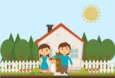 Happy family with house. Isolated Happy family near their own house Stock Images