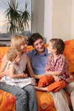 Happy family of the house on a sofa Stock Photography