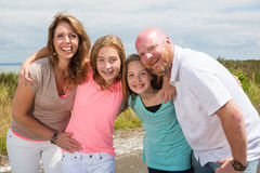 A happy family huddles together with happy smiles Stock Photos