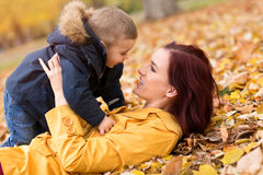 Happy family hug in the autumn leaves Royalty Free Stock Image