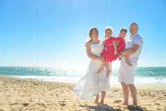 Happy family hugging on the beach Royalty Free Stock Image