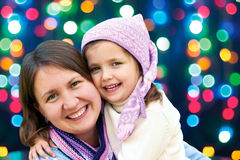 Happy family hugging the Christmas holidays Stock Image