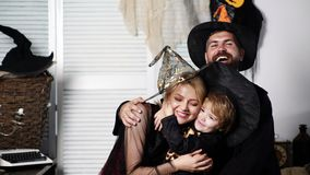 Happy family hugging in halloween costumes. Happy family mother father and children in costumes on a celebration of stock footage