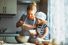 Happy Family In Kitchen. Mother And Child Preparing Dough, Bake Stock Photos