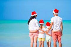 Free Happy Family In Red Santa Hats On A Tropical Beach Celebrating Christmas Vacation Stock Image - 163887901