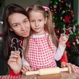 Happy Family In Santa Hats Baking Christmas Stock Photos
