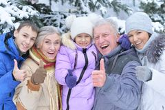 Happy Family In Snow Covered Winter Forest With Thumbs Up Royalty Free Stock Photography