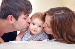 Happy family with infant baby girl Royalty Free Stock Photos
